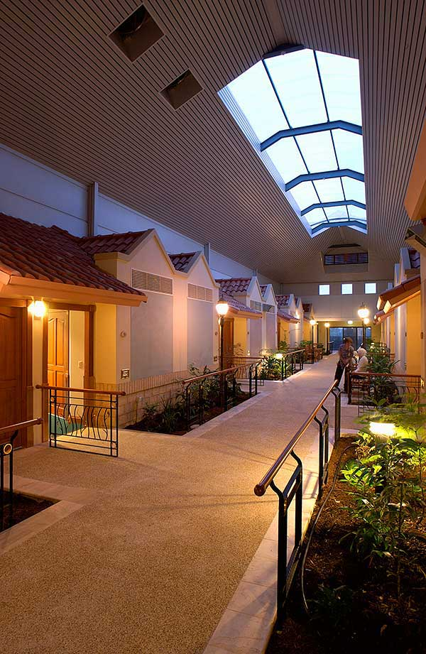 An outdoor corridor in Aged Care Retirement Bungalows at Regents Garden